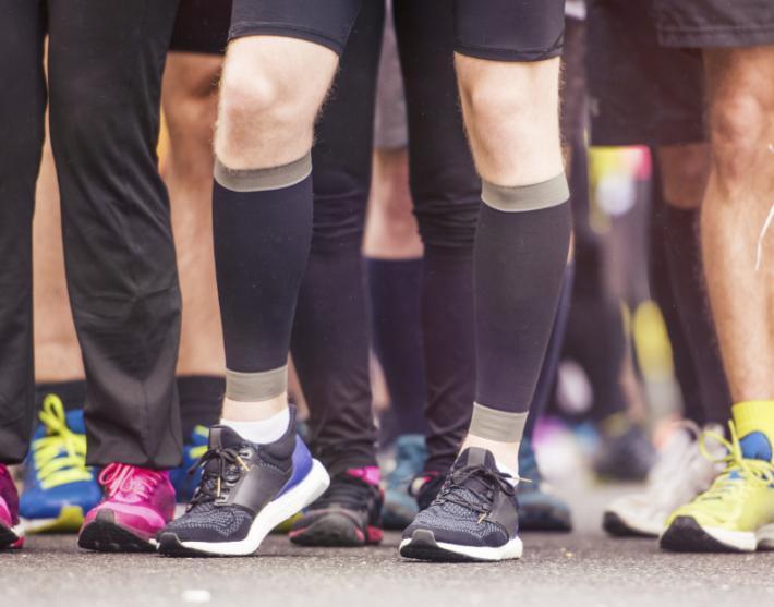 Runner wearing compression socks for shin splints