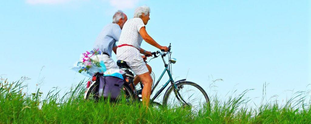 elderly riding bikes
