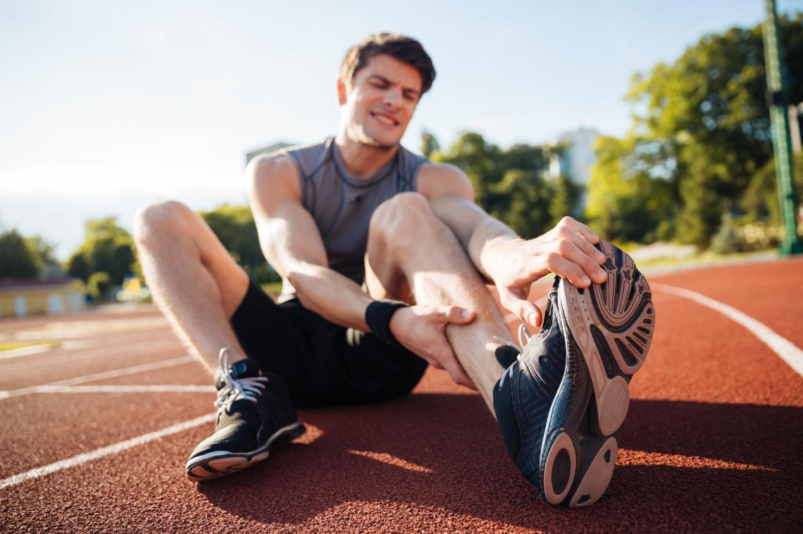 Runner on track with leg pain after exercising
