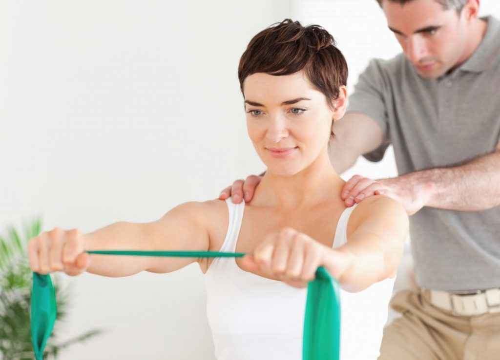 physical therapist and patient